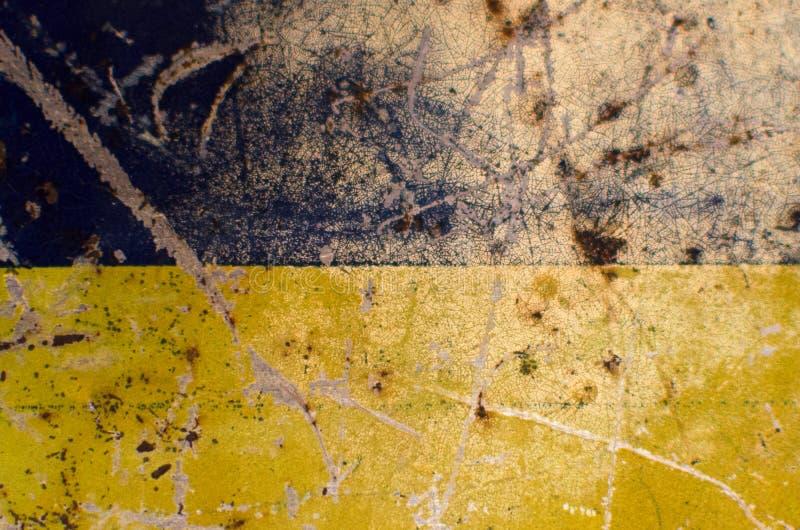 imagen Azul-amarilla del rasguñar-fondo del metal fotos de archivo libres de regalías
