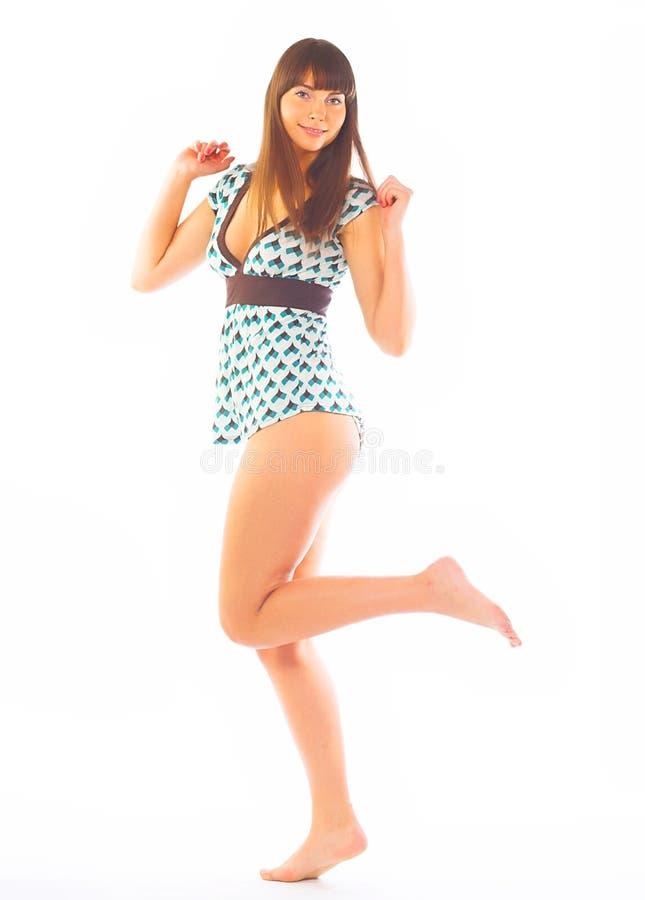 Imagen clásica del perno-para arriba de la morenita preciosa en blanco foto de archivo libre de regalías