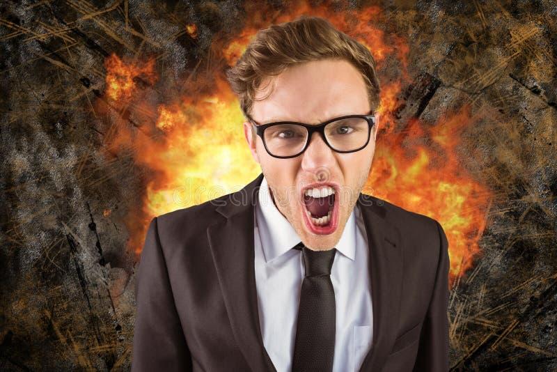 Imagen compuesta de Digitaces del hombre de negocios enojado con el fuego en fondo imagen de archivo libre de regalías
