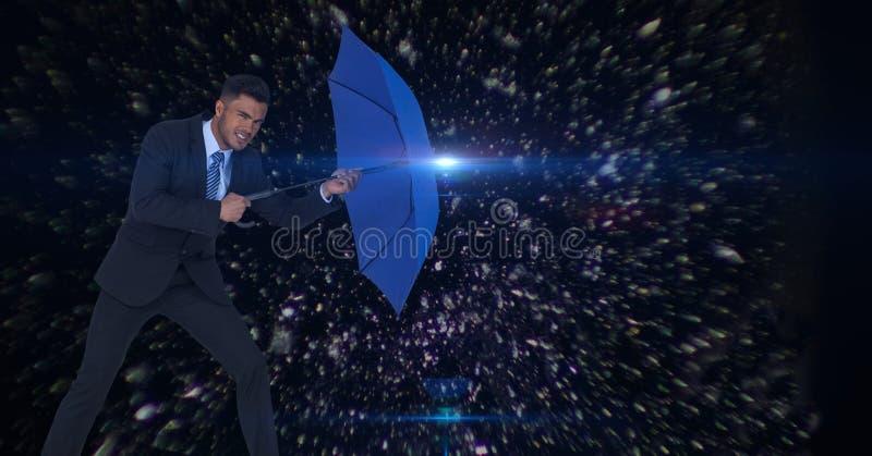 Imagen compuesta de Digitaces del hombre de negocios que sostiene el paraguas azul en medio de los asteroides foto de archivo libre de regalías