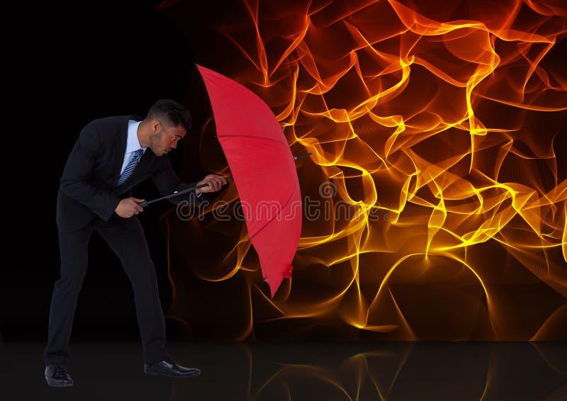 Imagen compuesta de Digitaces del hombre de negocios que sostiene el paraguas rojo contra el fuego libre illustration