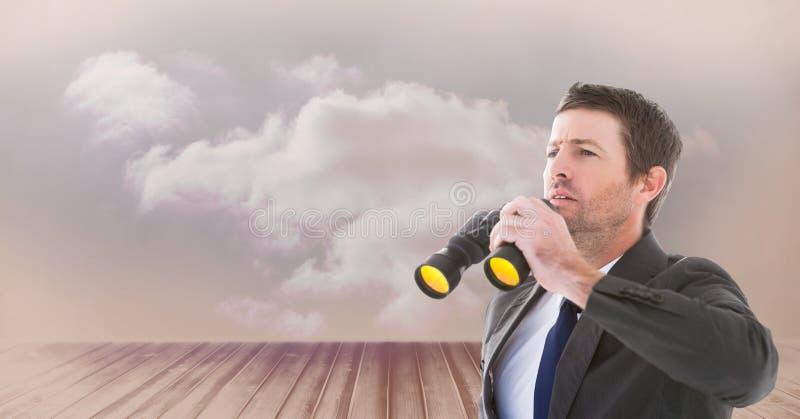 Imagen compuesta de Digitaces del hombre de negocios que sostiene los prismáticos mientras que mira lejos foto de archivo libre de regalías