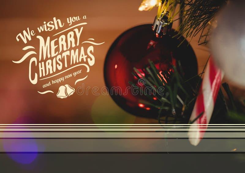 Imagen compuesta de Digital del mensaje de la Feliz Navidad y de la Feliz Año Nuevo contra la chuchería de la Navidad imagen de archivo libre de regalías