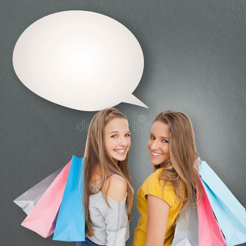 Imagen compuesta de dos mujeres jovenes con los panieres imagen de archivo