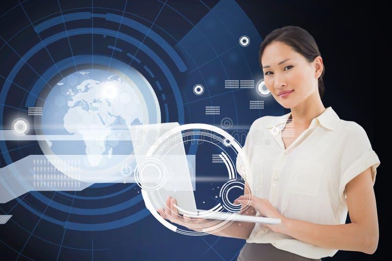 Imagen compuesta de la empresaria asiática que usa el ordenador portátil fotos de archivo libres de regalías