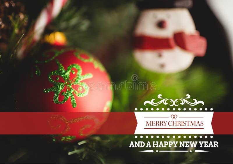 Imagen compuesta de la Feliz Navidad y Feliz Año Nuevo contra la decoración de la Navidad imagen de archivo libre de regalías