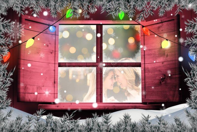 Imagen compuesta de la madre feliz con la hija que se mira contra el fondo blanco imagenes de archivo