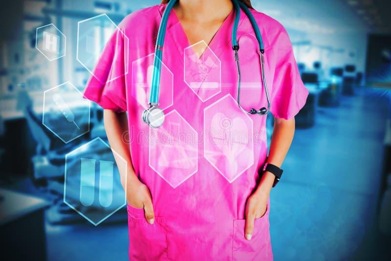 Imagen compuesta de la mediados de sección de la enfermera con el estetoscopio foto de archivo