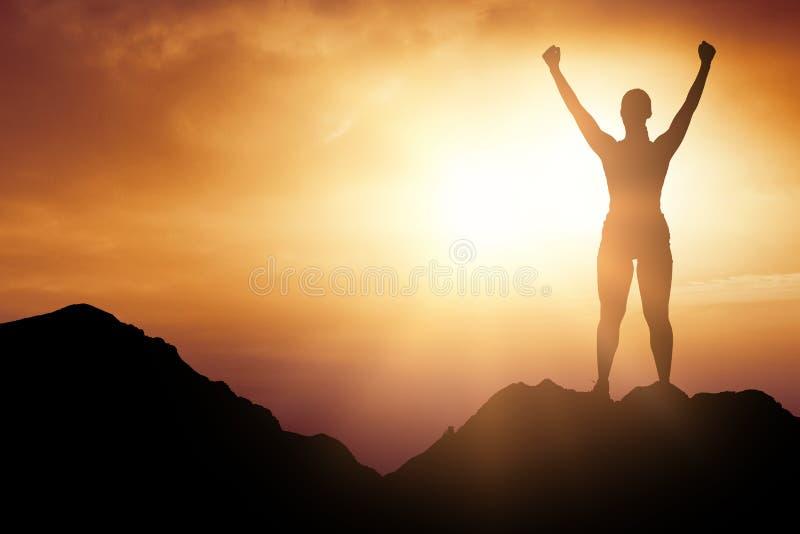 Imagen compuesta de la mujer alegre con los brazos aumentados mientras que se coloca imagen de archivo libre de regalías