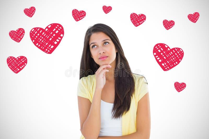 Imagen compuesta de la mujer casual feliz que piensa con la mano en la barbilla imagen de archivo libre de regalías