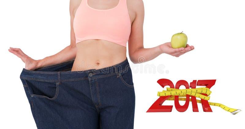 Imagen compuesta de la mujer que muestra su cintura después de peso perdidoso imágenes de archivo libres de regalías