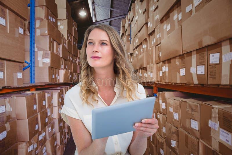 Imagen compuesta de la mujer que usa la PC de la tableta foto de archivo libre de regalías