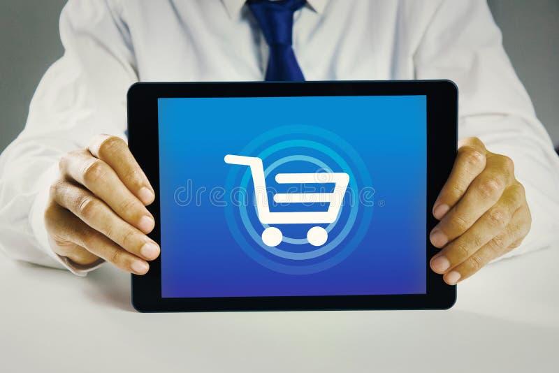 Imagen compuesta de la PC de la tableta de la demostración del hombre de negocios fotografía de archivo