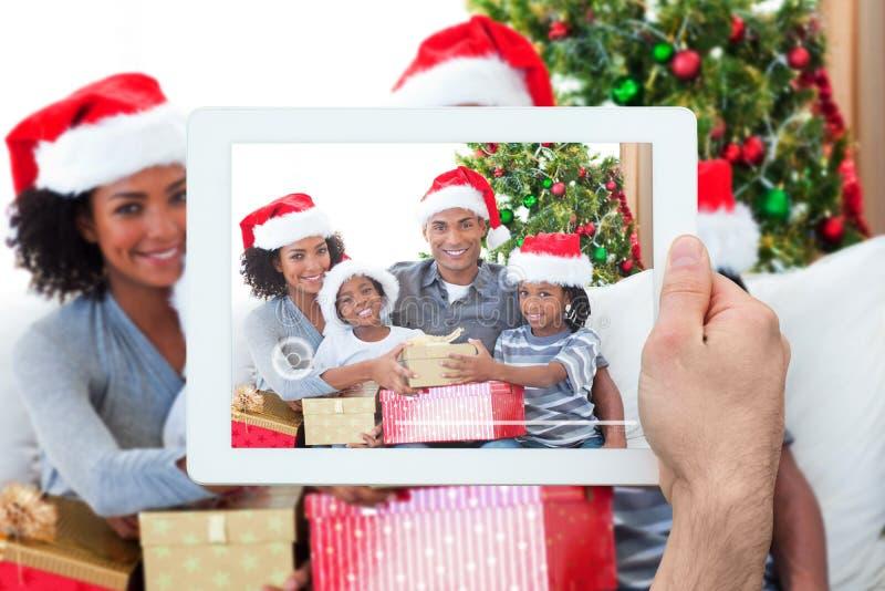 Imagen compuesta de la PC de la tableta de la tenencia de la mano fotografía de archivo
