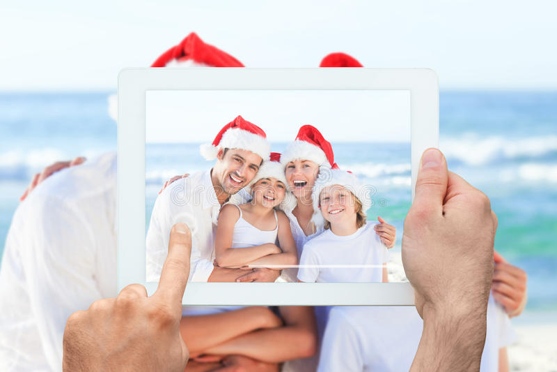 Imagen compuesta de la PC de la tableta de la tenencia de la mano foto de archivo