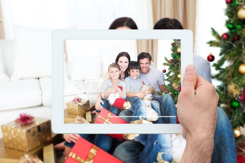 Imagen compuesta de la PC de la tableta de la tenencia de la mano foto de archivo libre de regalías