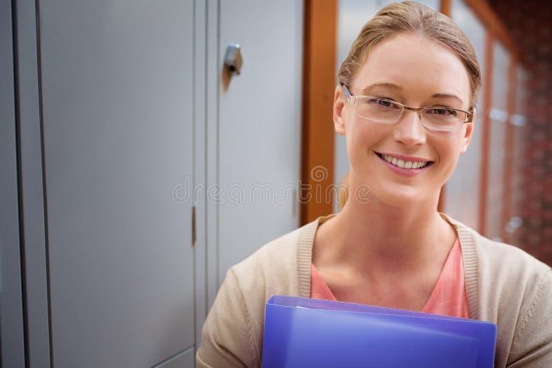 Imagen compuesta de la sonrisa de enseñanza del estudiante fotografía de archivo