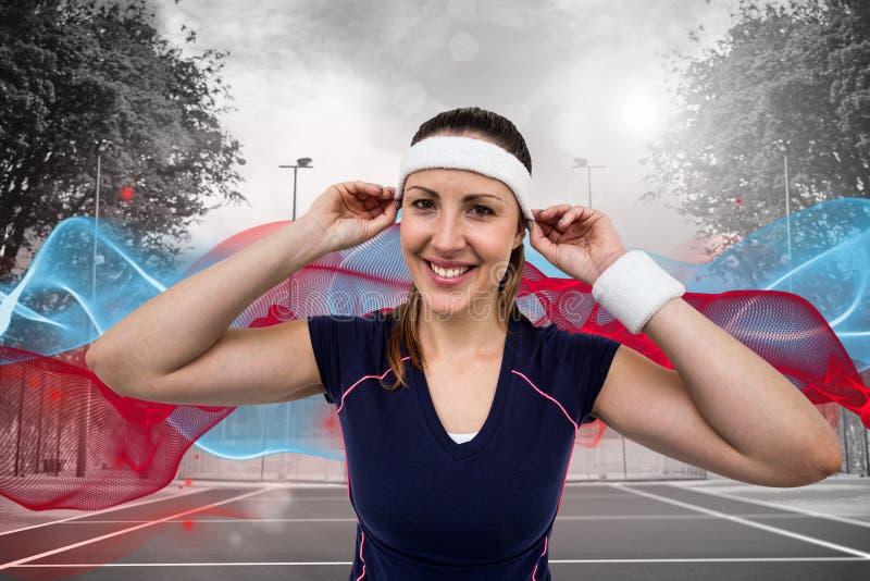 Imagen compuesta de la venda que lleva y de la pulsera del atleta de sexo femenino foto de archivo libre de regalías