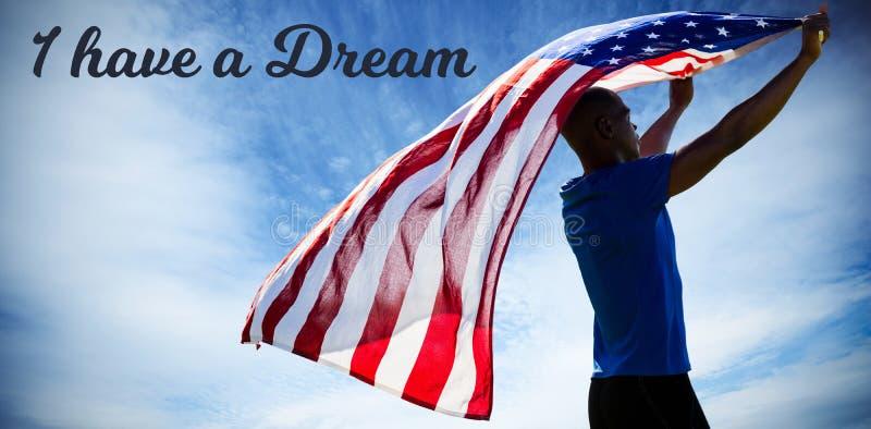 Imagen compuesta de la vista posterior del deportista que aumenta una bandera americana imagen de archivo