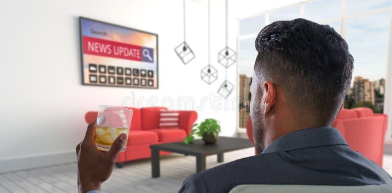 Imagen compuesta de la vista posterior del hombre de negocios que sostiene el whisky de cristal fotos de archivo libres de regalías
