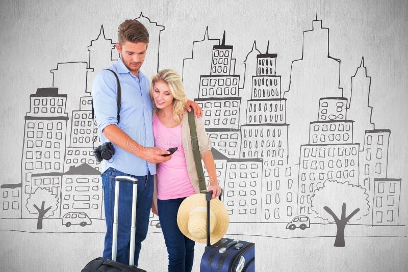 Imagen compuesta de los pares jovenes atractivos listos para ir el vacaciones fotografía de archivo libre de regalías