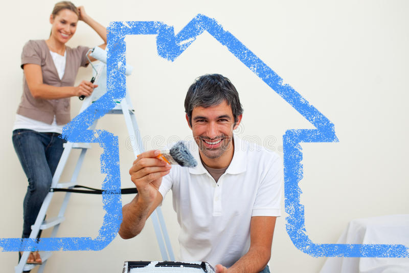 Imagen compuesta de los pares sonrientes que pintan una pared stock de ilustración