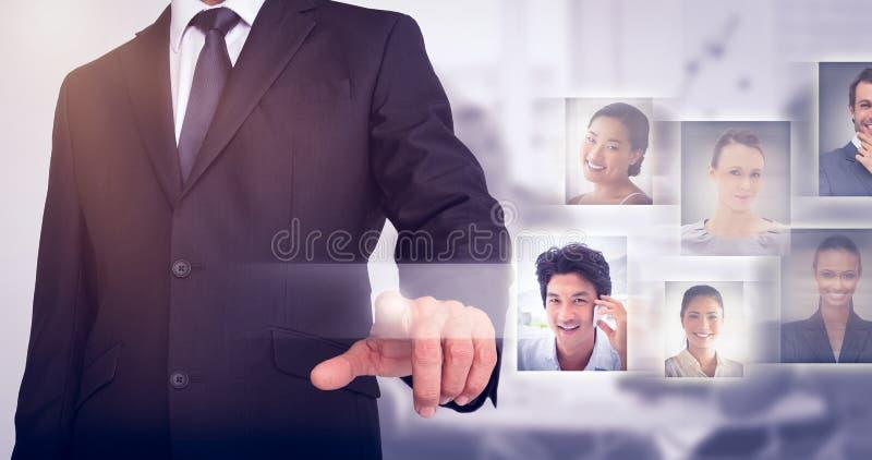 Imagen compuesta de señalar del hombre de negocios imagen de archivo