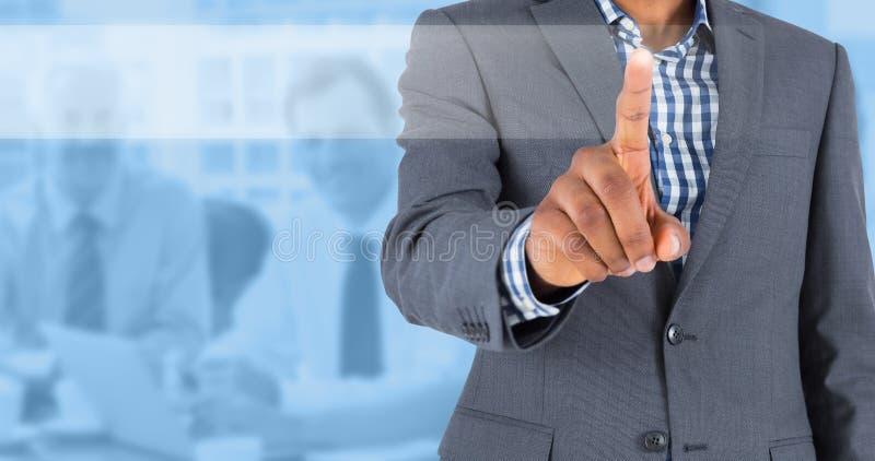 Imagen compuesta de señalar enfocado del hombre de negocios imágenes de archivo libres de regalías