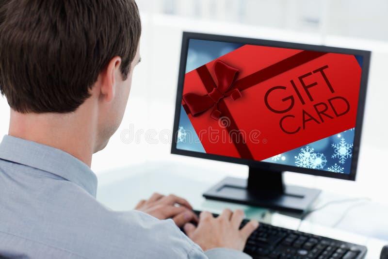 Imagen compuesta del carte cadeaux con el arco festivo fotografía de archivo
