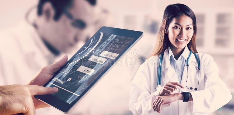 Imagen compuesta del doctor asiático que usa su reloj elegante foto de archivo libre de regalías