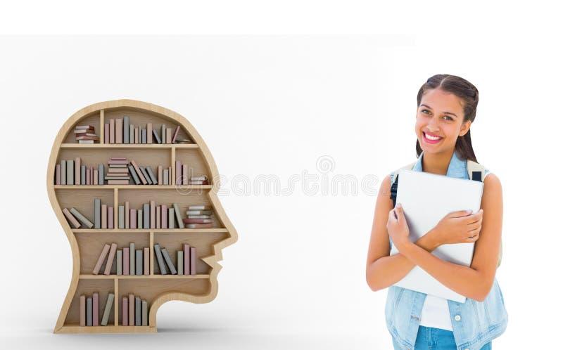Imagen compuesta del estudiante que sostiene el ordenador portátil fotografía de archivo libre de regalías