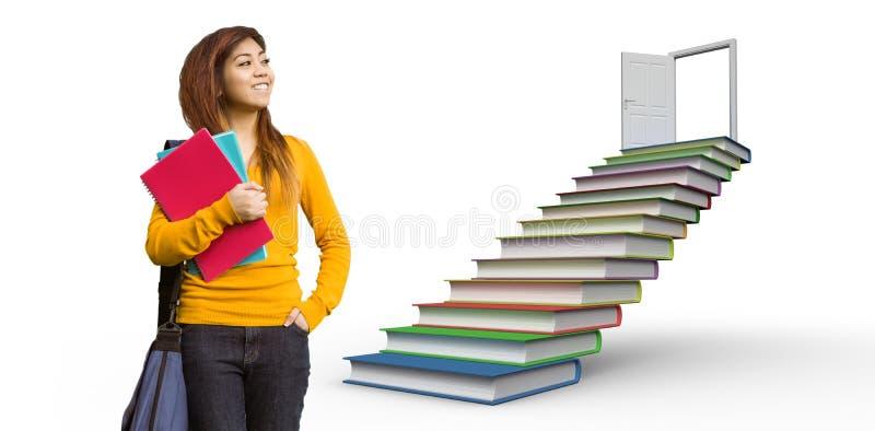 Imagen compuesta del estudiante universitario de sexo femenino con los libros en parque foto de archivo