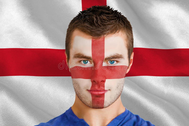 Imagen compuesta del fan joven serio de Inglaterra con el facepaint fotografía de archivo libre de regalías