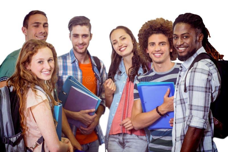Imagen compuesta del grupo sonriente de estudiantes que sostienen carpetas fotos de archivo libres de regalías