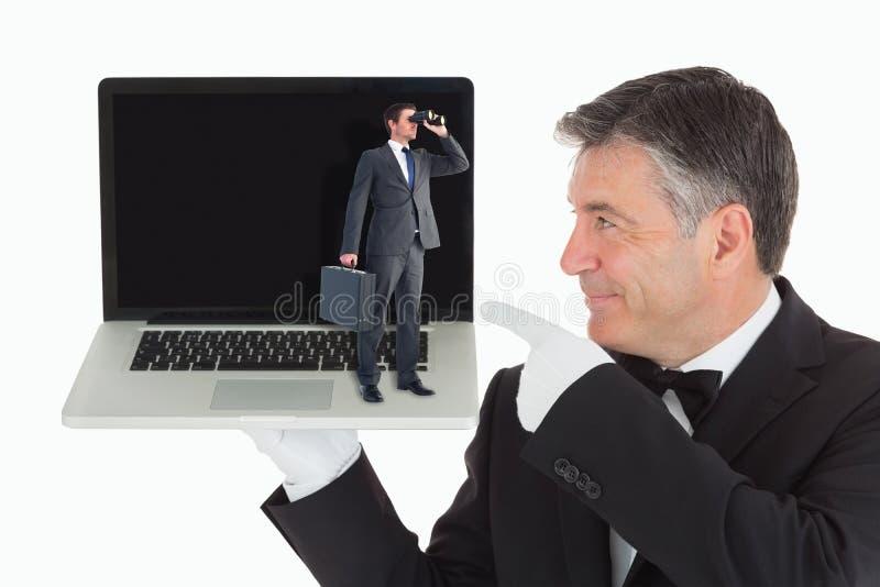 Imagen compuesta del hombre de negocios que mira a través de los prismáticos fotografía de archivo