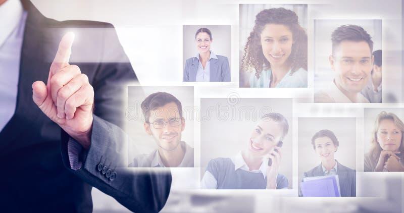 Imagen compuesta del hombre de negocios que señala su finger en la cámara imagenes de archivo