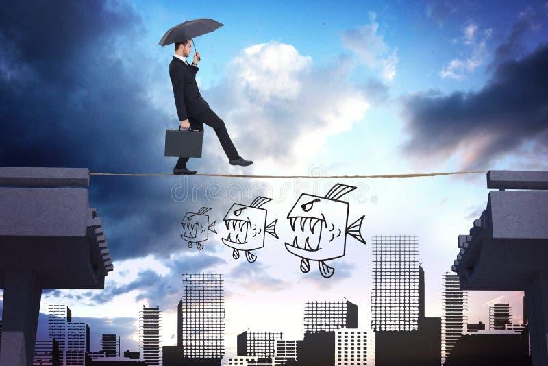 Imagen compuesta del hombre de negocios que sostiene la cartera debajo del paraguas imagenes de archivo