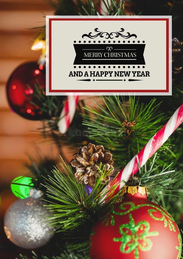 Imagen compuesta del mensaje de la Feliz Navidad y de la Feliz Año Nuevo fotografía de archivo