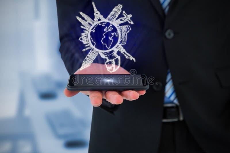 Imagen compuesta del midsection del hombre de negocios que sostiene el teléfono móvil foto de archivo