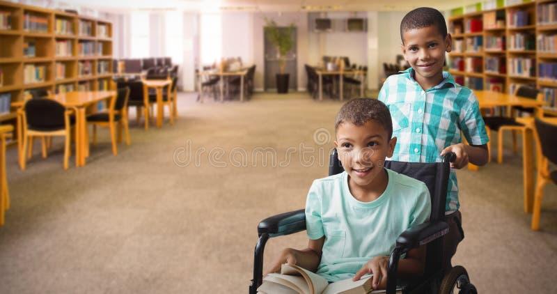 Imagen compuesta del muchacho que empuja al amigo en la silla de ruedas imágenes de archivo libres de regalías