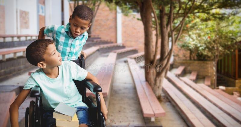 Imagen compuesta del muchacho que empuja la silla de ruedas mientras que amigo que lo mira foto de archivo libre de regalías