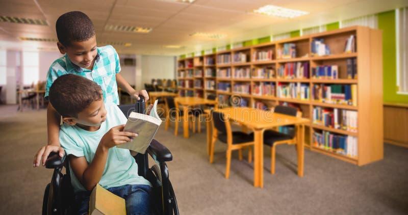 Imagen compuesta del muchacho que empuja la silla de ruedas mientras que libro de lectura del amigo imagen de archivo libre de regalías
