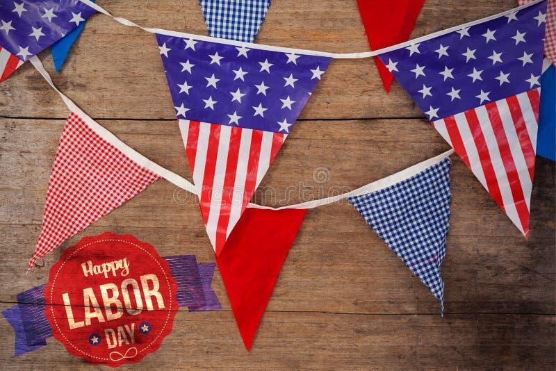 Imagen compuesta del texto feliz del Día del Trabajo en bandera foto de archivo