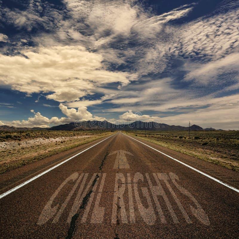 Imagen conceptual del camino con las derechas civiles de las palabras fotografía de archivo libre de regalías