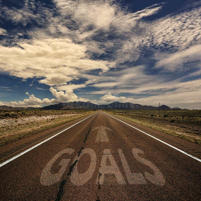 Imagen conceptual del camino con las metas de la palabra fotografía de archivo libre de regalías