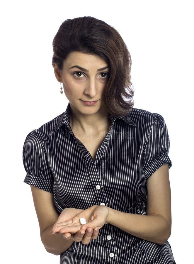 Imagen de la mujer joven con las píldoras imagenes de archivo