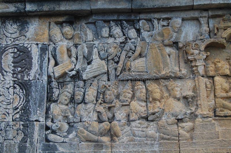 Imagen de la pared de piedra tallada, templo de Borobudur, Java, Indonesia imagen de archivo