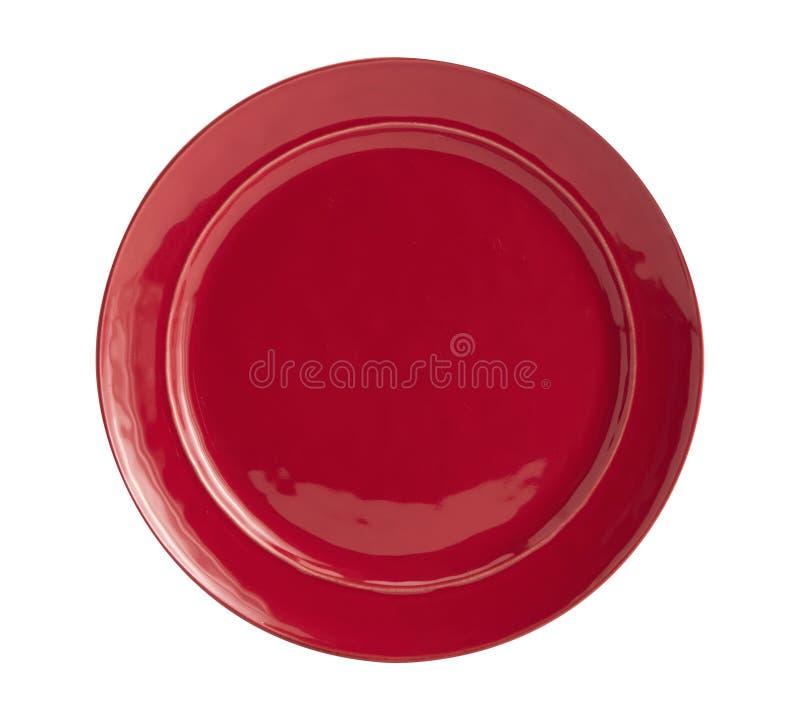 Imagen de la placa roja, gato/perro que alimenta el cuenco rojo, visión desde arriba; aislado en el fondo blanco, placa roja en e imagen de archivo libre de regalías