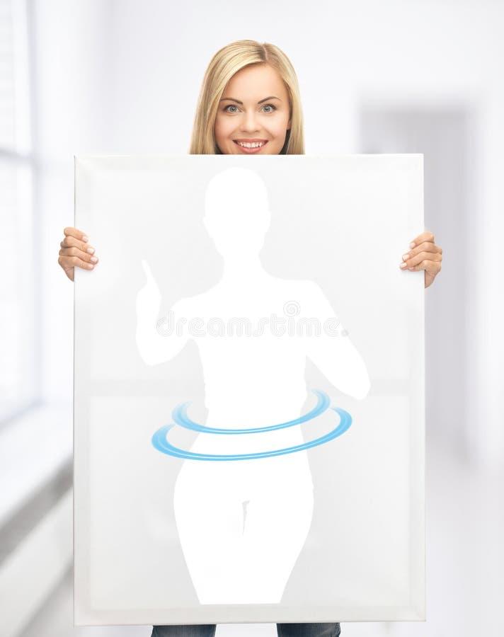Imagen de la tenencia de la mujer de la mujer de dieta imágenes de archivo libres de regalías