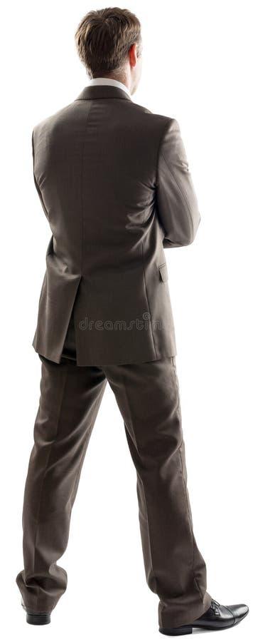 Imagen de la vista posterior del ejecutivo de operaciones de sexo masculino joven imagenes de archivo